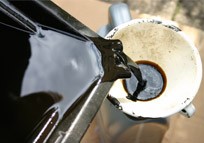 used oil being poured into recepticle